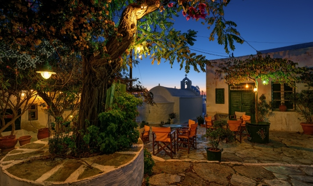 small cafe in Chora of Amorgos, chairs, lights, tree, night, ferry itineraries