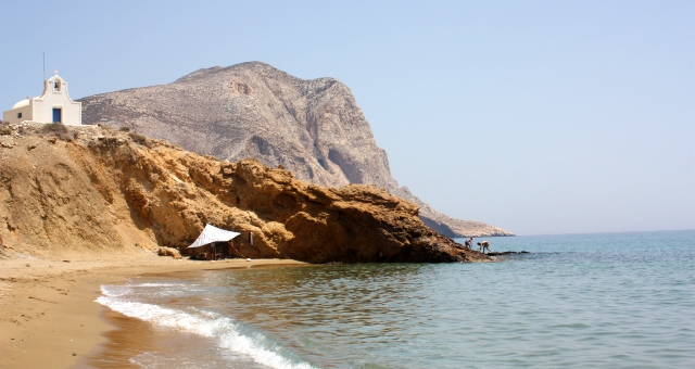 Sandy beach and little church with Kalamos in the background