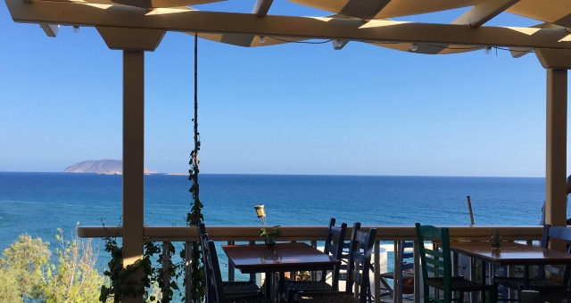 Cafe margarita in Kleisidi, view to the blue sea and horizon of Aegean, Anafi island, holidays, ferry tickets
