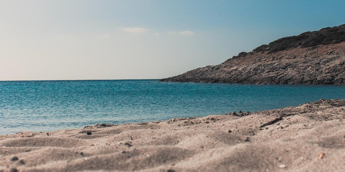 Rocky beach with deep blue waters in Antiparos
