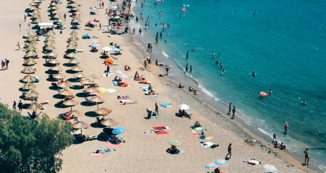 Sandy beach with umbrellas in Athens