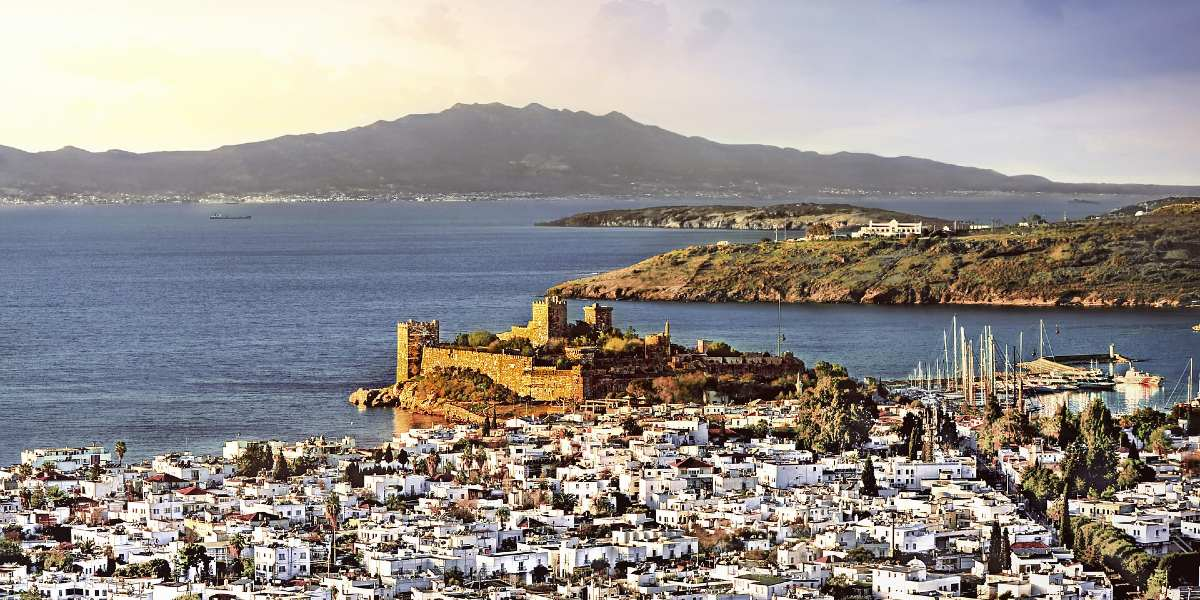 Castle by the sea in Bodrum, aerial view of the city of Bodrum, Turkey - Greece ferry routes