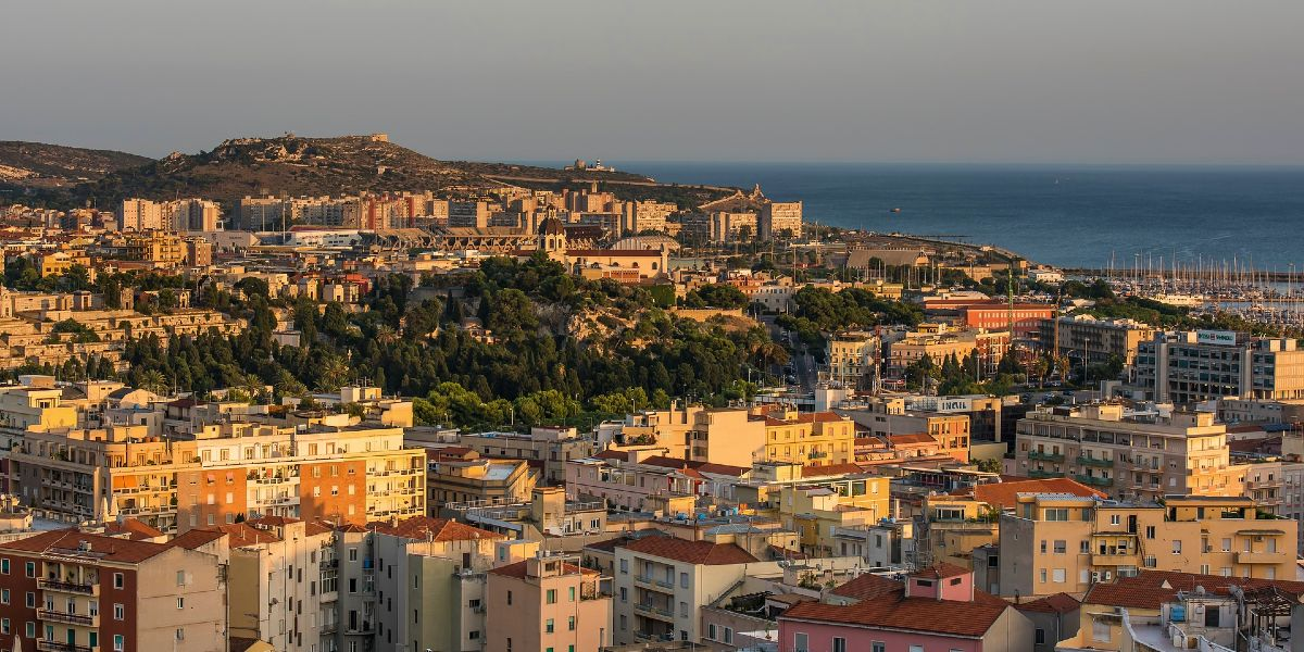 Sunset over the city and port of Cagliari, Sardinia, ferry tickets