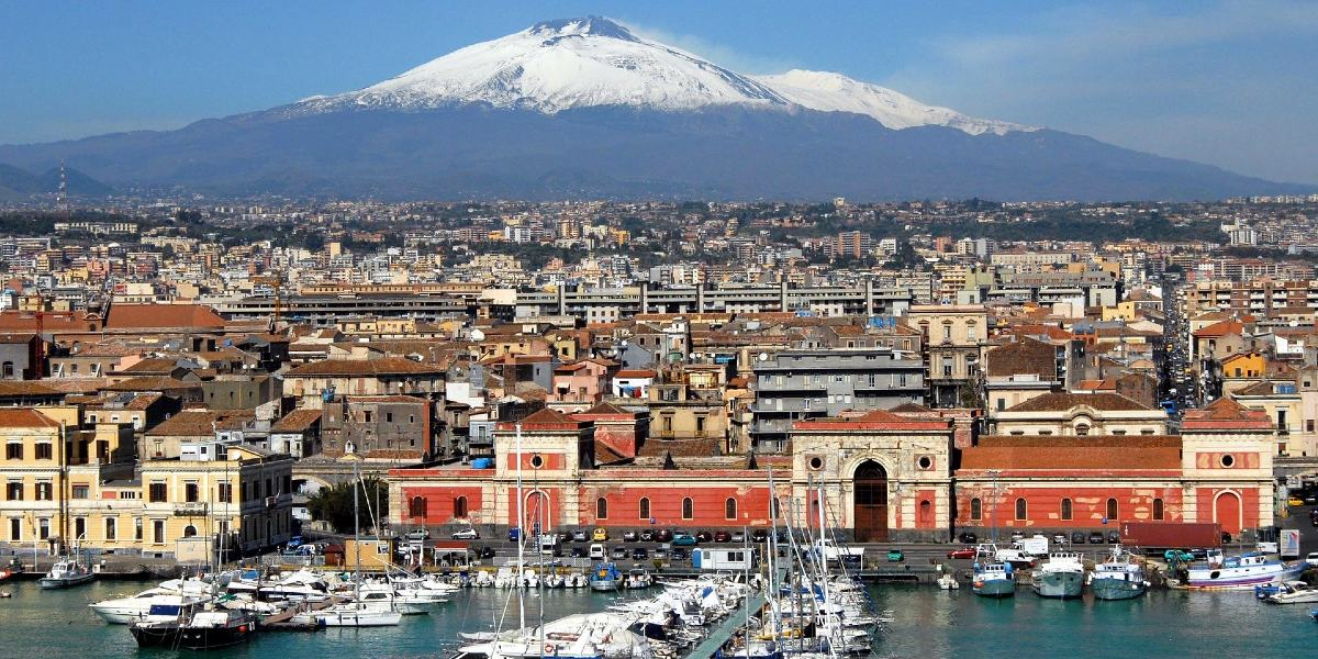 The port of Catania, view of the Etna volcano, snow, ferry routes and tickets