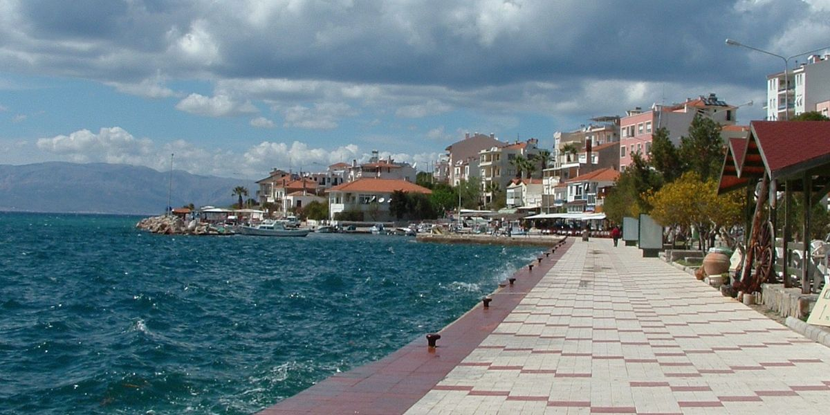 windy day in Cesme, port and rough sea, clouds, tiles, travel by ferry to cesme