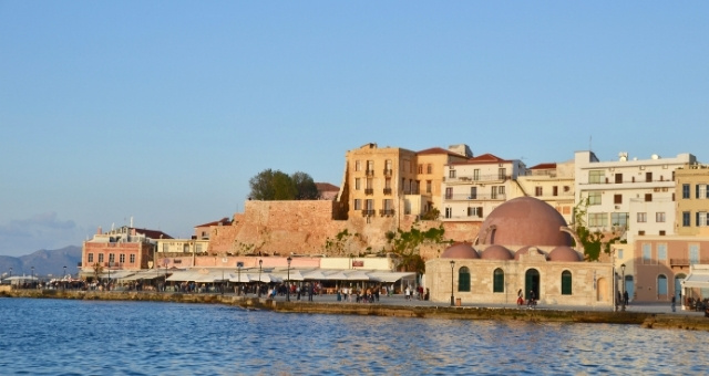 Venetian port of Chania, mosque, promenade, shops, houses, people