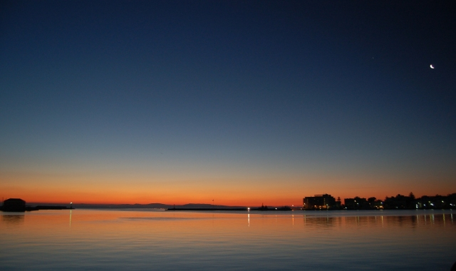 dark blue and orange sky, sunset, port of Chios, calm sea, ferry routes
