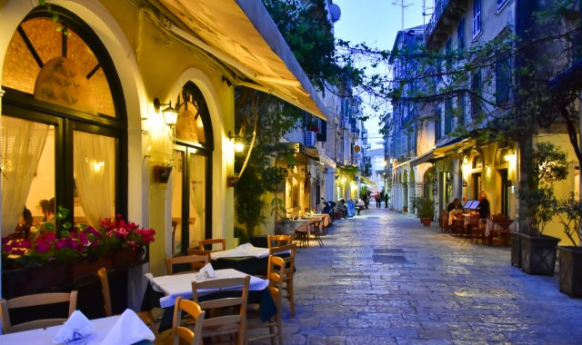 Traditional restaurants in the old town of Corfu right before sunset