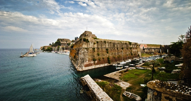 Castle in the port of Corfu, sailing boat, fishing boats, blue sea, landscape, Ionian islands, ferry tickets