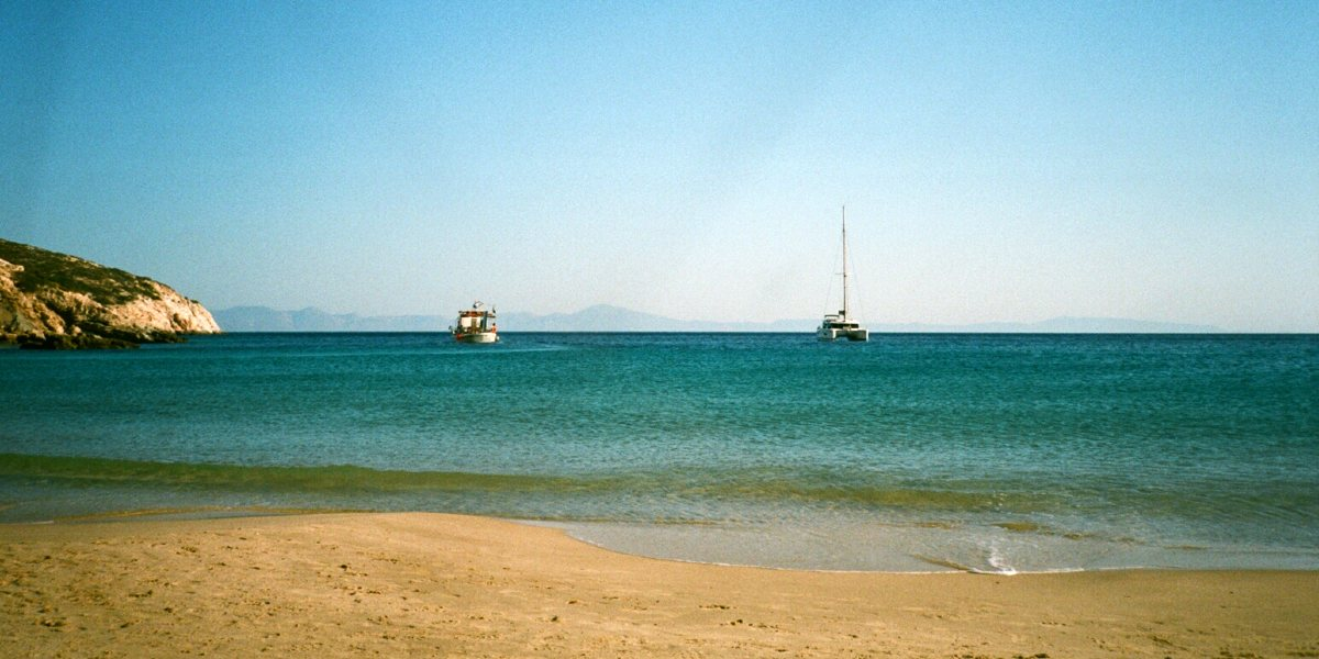 Fishing boats off the sandy Kedros beach in Donousa