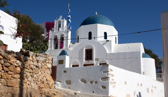 White church with blue dome in Donousa, typical of Cycladic architecture