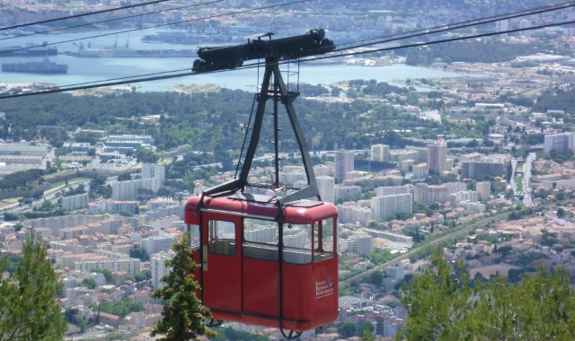 Red cable car that takes you from Toulon to the top of the Mount Faron, view Toulon port, ferry routes