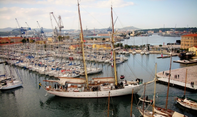 Sailing boats and cranes at the port of Toulon, south France - ferry routes and tickets