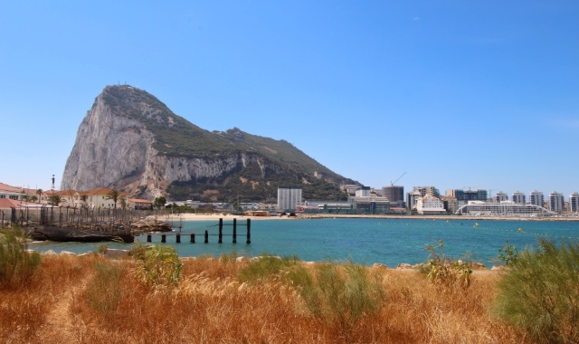 Harbour in Gibraltar, view of the rock, buildings, city architecture, holidays, ferry tickets