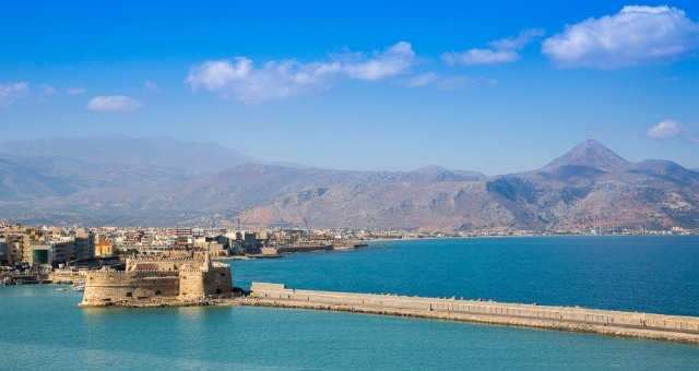 Venetian fortress, port of Heraklion, promenade, coastal city, mountains, cranes, blue sky