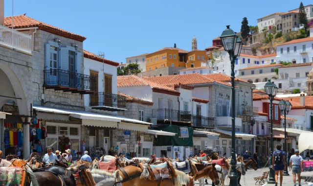 Houses, shops, people and donkeys in the port and town of Hydra, traditional architecture, transport, ferry routes and tickets