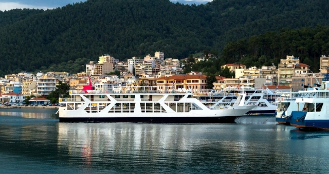 Ferry boats in the port of Igoumenitsa, coastal town, buildings, forest, Ionian sea