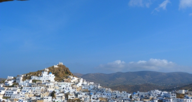 Chora of Ios island, village, white houses, churches, cliff, blue sky, clouds