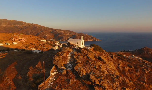 Small church on a top of a hill in Ios island, sunset hour, colour, white houses, hiking, summer holidays, ferry tickets