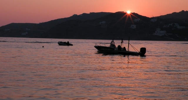 Fishing boats, sunset hours, pink sky, port of Ios, island