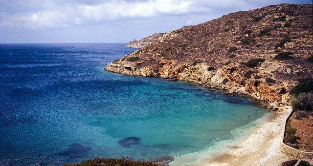 Sandy beach and blue sea in Ios, holidays in Cyclades, ferry routes to Santorini - Mykonos