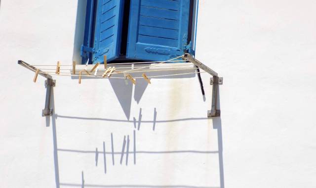 blue window, clothespins, white house in Schinoussa