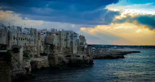 Polignano a Mare, beach close to Bari, architecture, blue sea, clouds, sunset, holidays in Italy, ferry tickets