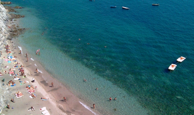 Sandy beach, crystal waters, swimmers, Capri, Positano, ferry routes