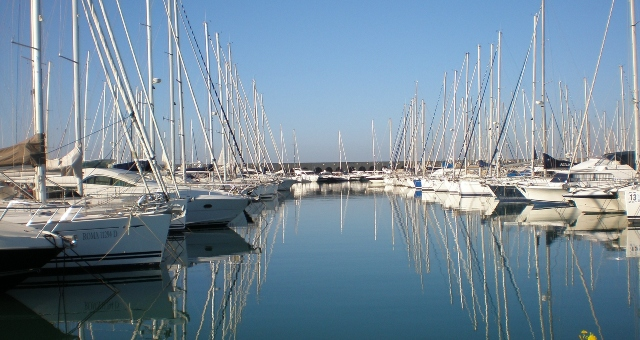 Marina of Civitavecchia, sailing boats, calm sea, port of Rome, ferry routes to the Mediterranean