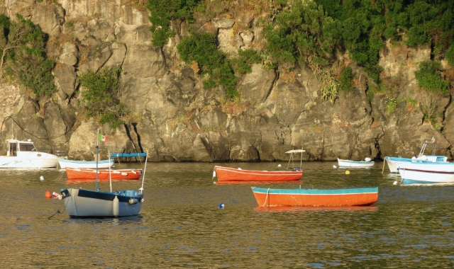 Orange fish boats, rocks, Positano, Ischia, Ferry routes