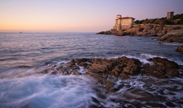 Sunset view in the sea of Livorno, Tuscany - castle and nature, tickets for the ferry to and from Sardinia