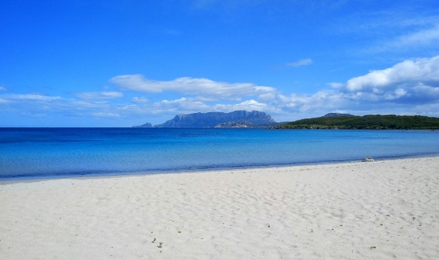 Sandy beach outside Olbia, blue sea, island, holidays in Italy, and ferry tickets from mainland Italy to Sardinia