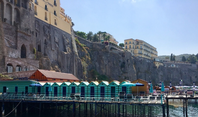 Blue cabins and dock, traditional buildings, Sorrento, Naples, ferry routes