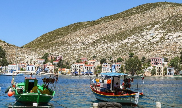 green and red boat, mountain, Chora in Kastellorizo, houses