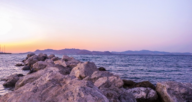 sunset, orange and blue sky, rocks, sea, ferry route from Kos to Bodrum