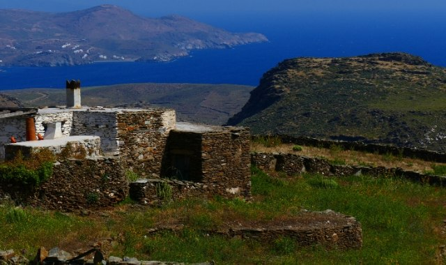 green nature, stone building, blue sea in Kythnos
