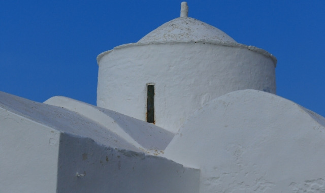 white chapel under the blue sky in Kythnos