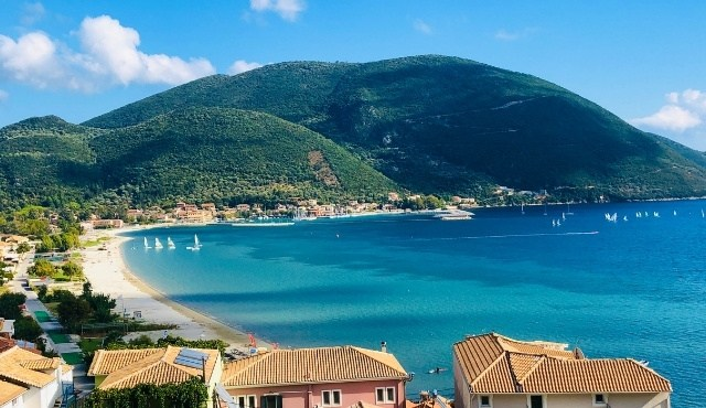 The seaside village of Vasiliki by the green hills