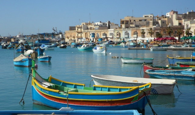 Colorful boats, sailing and fish boats, buildings, Malta, Catania, ferry routes