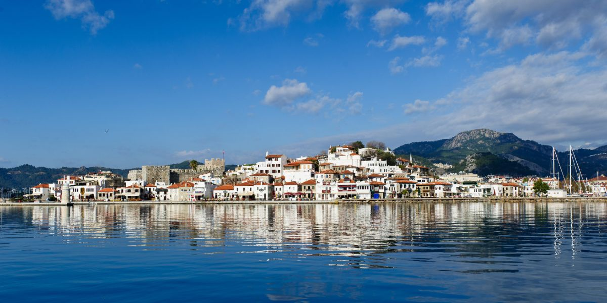 the city of Marmaris, blue sea and sky, clouds, white houses with red rooftops, ferry trip to Turkey