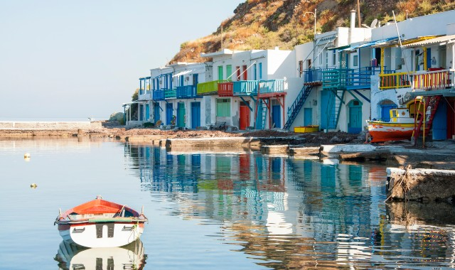 Fishing boats at the village of Klima in Milos