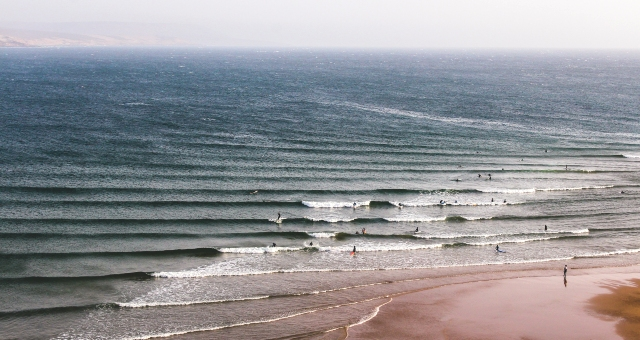 Sandy beach and waves in Morocco, surfing holidays, ferry tickets to Spain