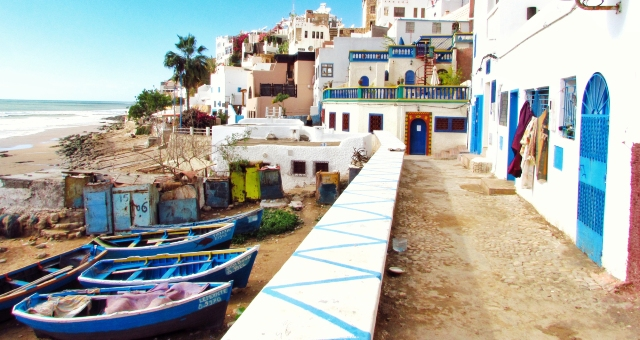 Colourful coastal town in Morocco, boats, palm trees, sea, ferry tickets