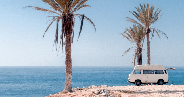 Palm trees, blue sea, sky, white van, Morocco holidays, ferry routes, tickets