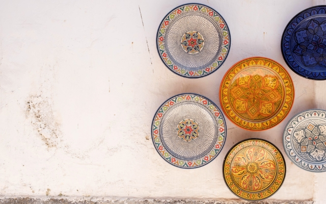 Decorative plates on a wall in Morocco, colours, holidays, ferry routes