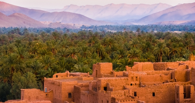 Sunset in Tamnougalt, Morocco, mountains, palm tree forest, ancient city, holidays, ferry tickets