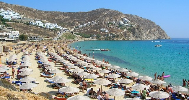 Umbrellas and sunbeds on the beach of Elia