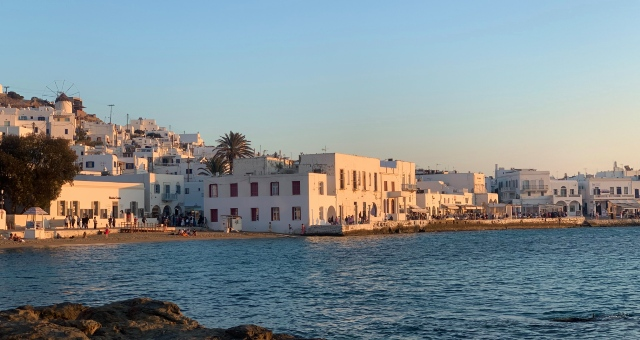 Sunset in Mykonos Town, white houses, Cyclades, windmills, trees, sea