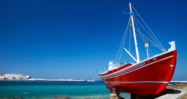 Red boat, old port Mykonos, old town, blue sky, white houses