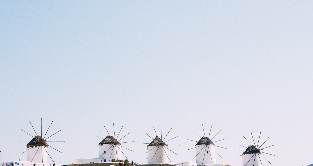 Traditional windmills in Mykonos, white and blue, Cyclades colours, architecture, ferry tickets from Mykonos